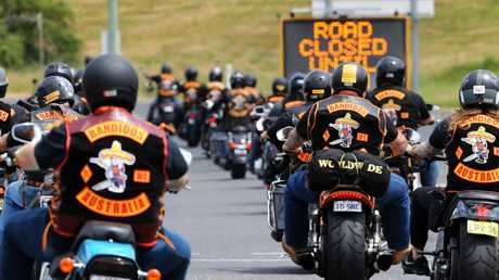 Police keep a watchful eye on the Bandidos' motorcycle gang as they arrive in Tasmania in 2017. Picture: Chris Kidd
