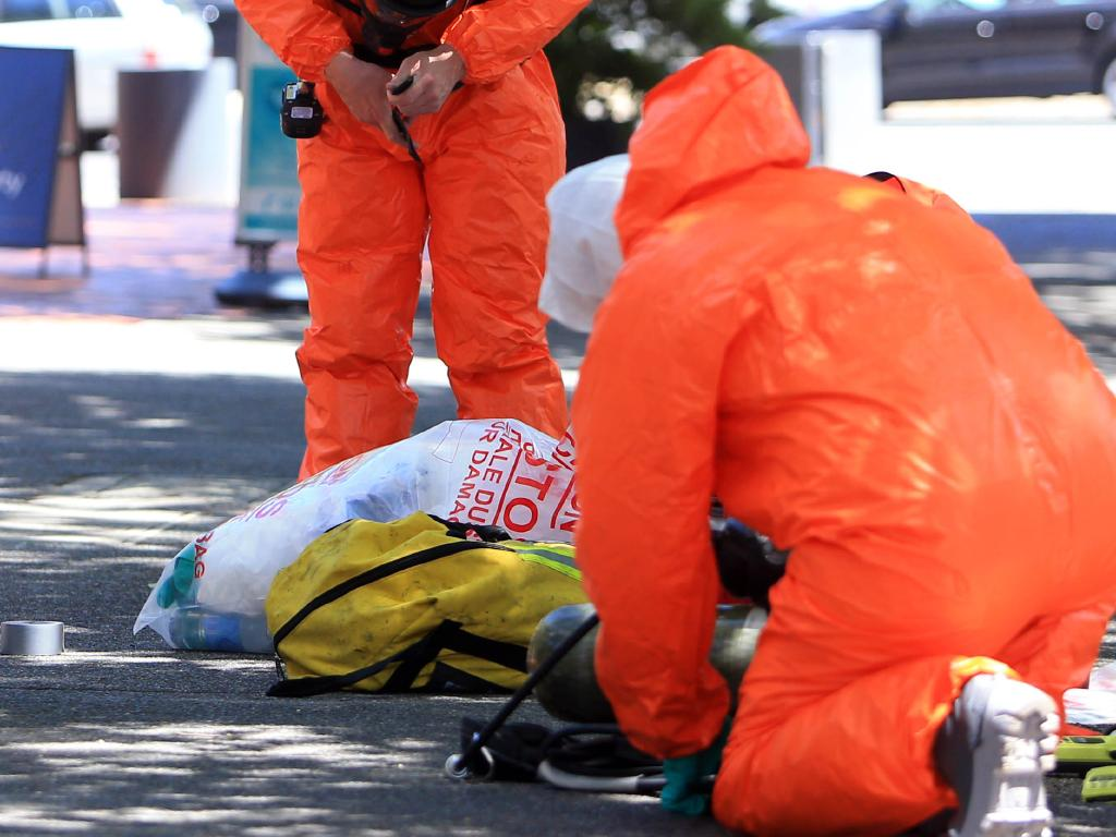 Firemen wearing hazmat suits outside the Greek Consulate in Melbourne. Picture: Aaron Francis/The Australian
