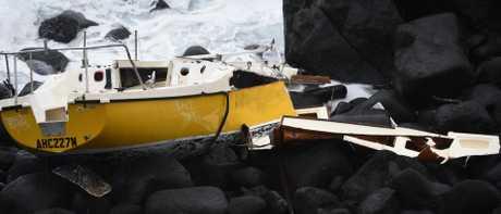 A yacht has been abandoned on the rocks at Burleigh Headland. (Photo/Steve Holland)