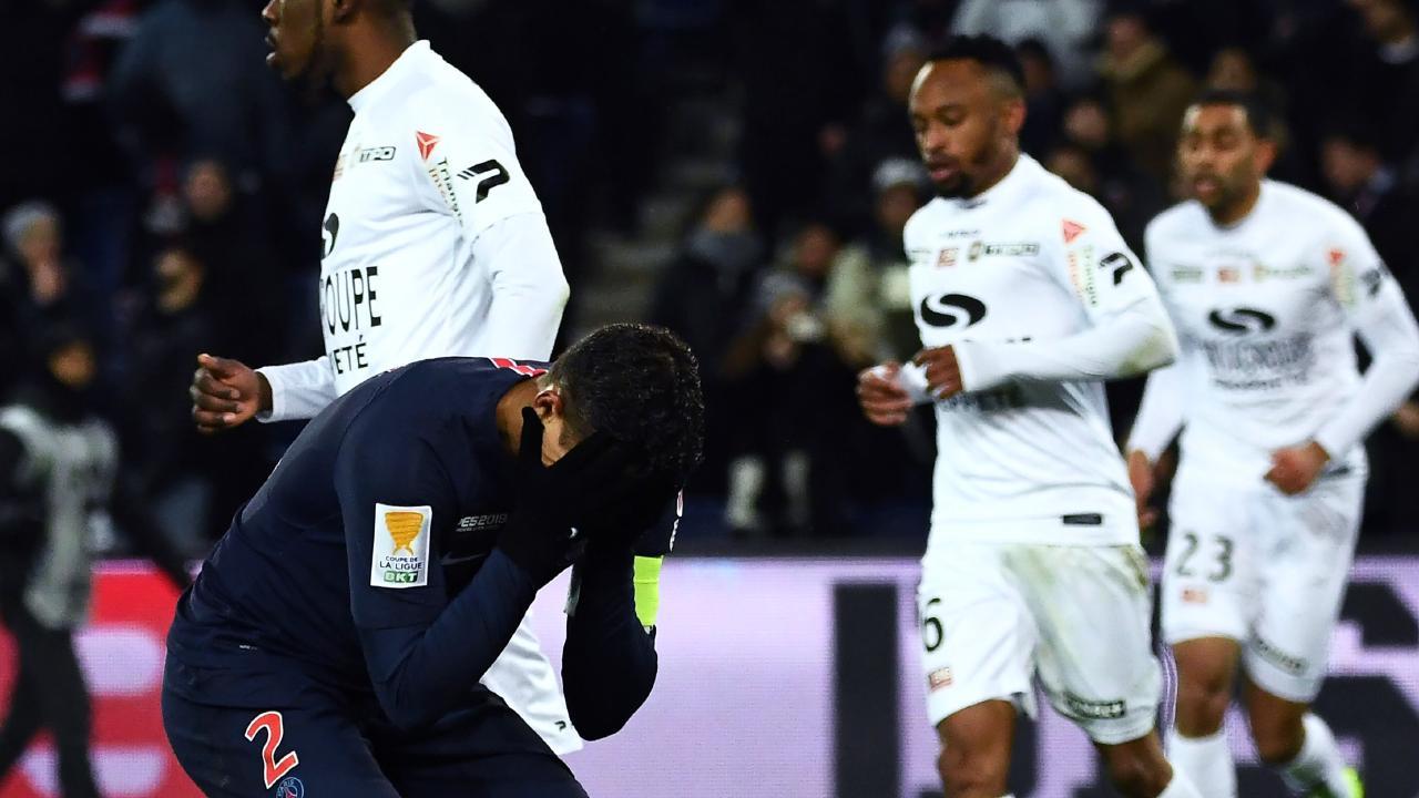 Paris Saint-Germain's Brazilian defender Thiago Silva (L) reacts during the French League Cup quarter-final