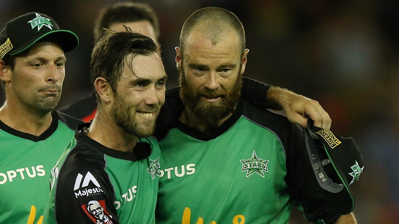 Glenn Maxwell (L) gives then Melbourne Stars teammate Rob Quiney a post-game hug. Picture: Wayne Ludbey