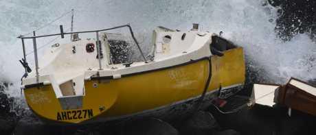 A yacht has been left on the rocks at Burleigh Headland. (Photo/Steve Holland)