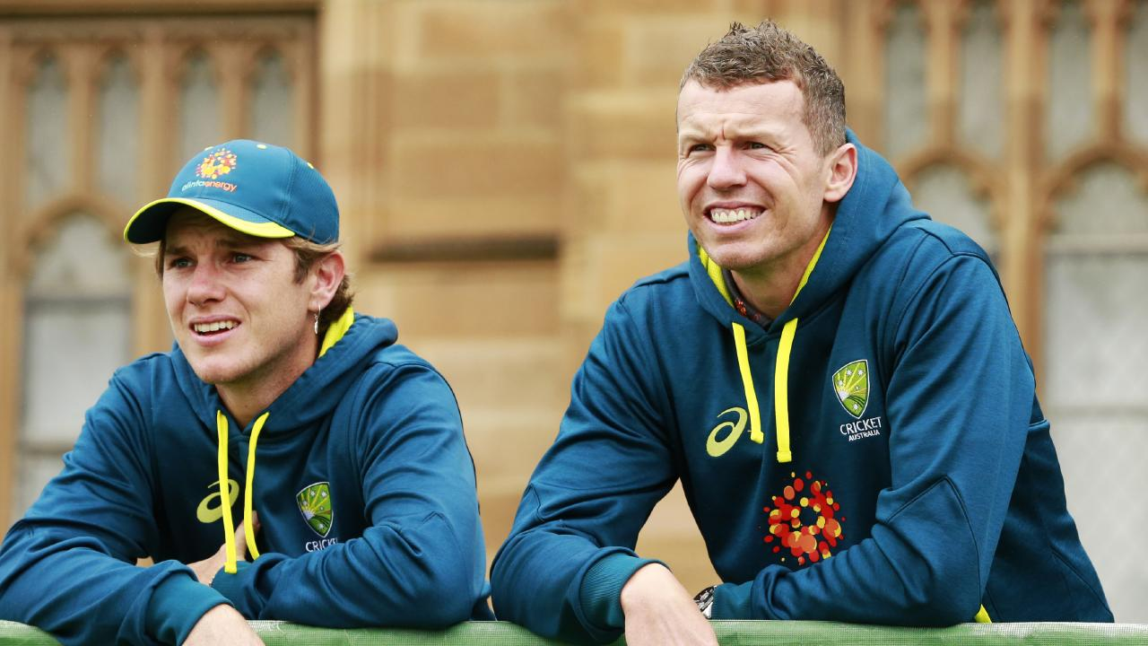Adam Zampa and Peter Siddle have a history of hamming it up in Australian team photos.