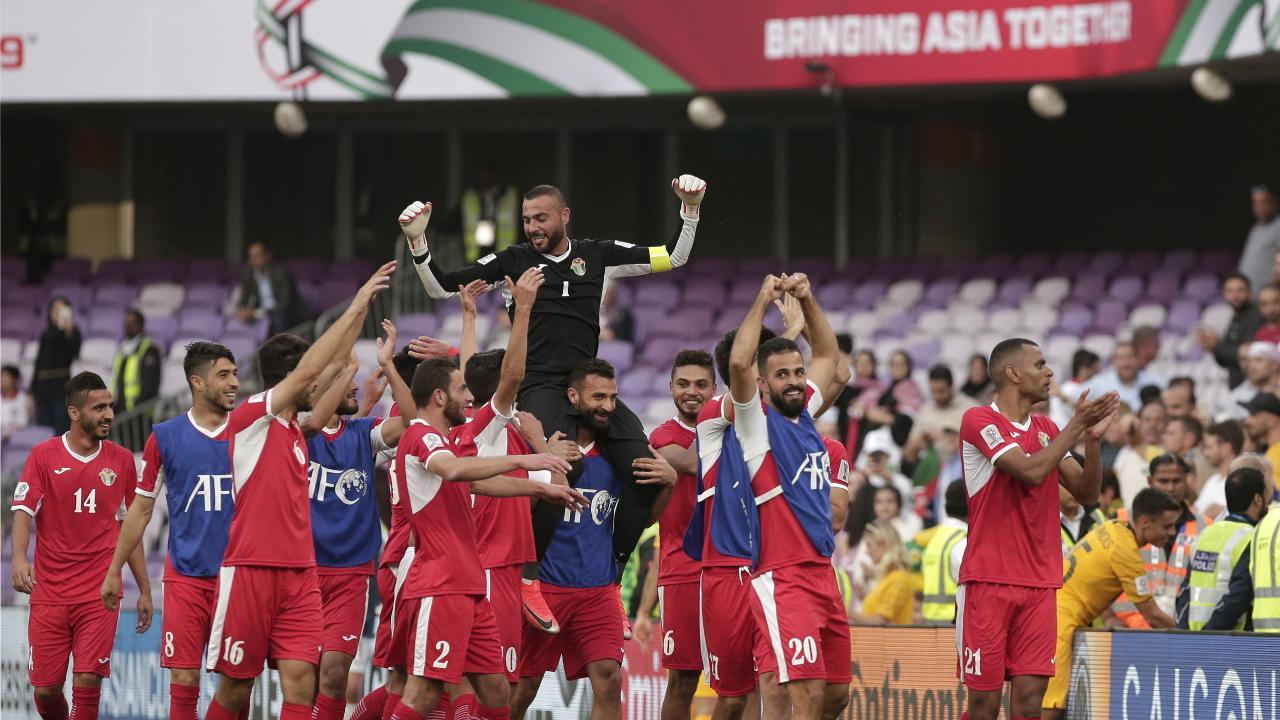 Jordan celebrate their win over the Socceroos