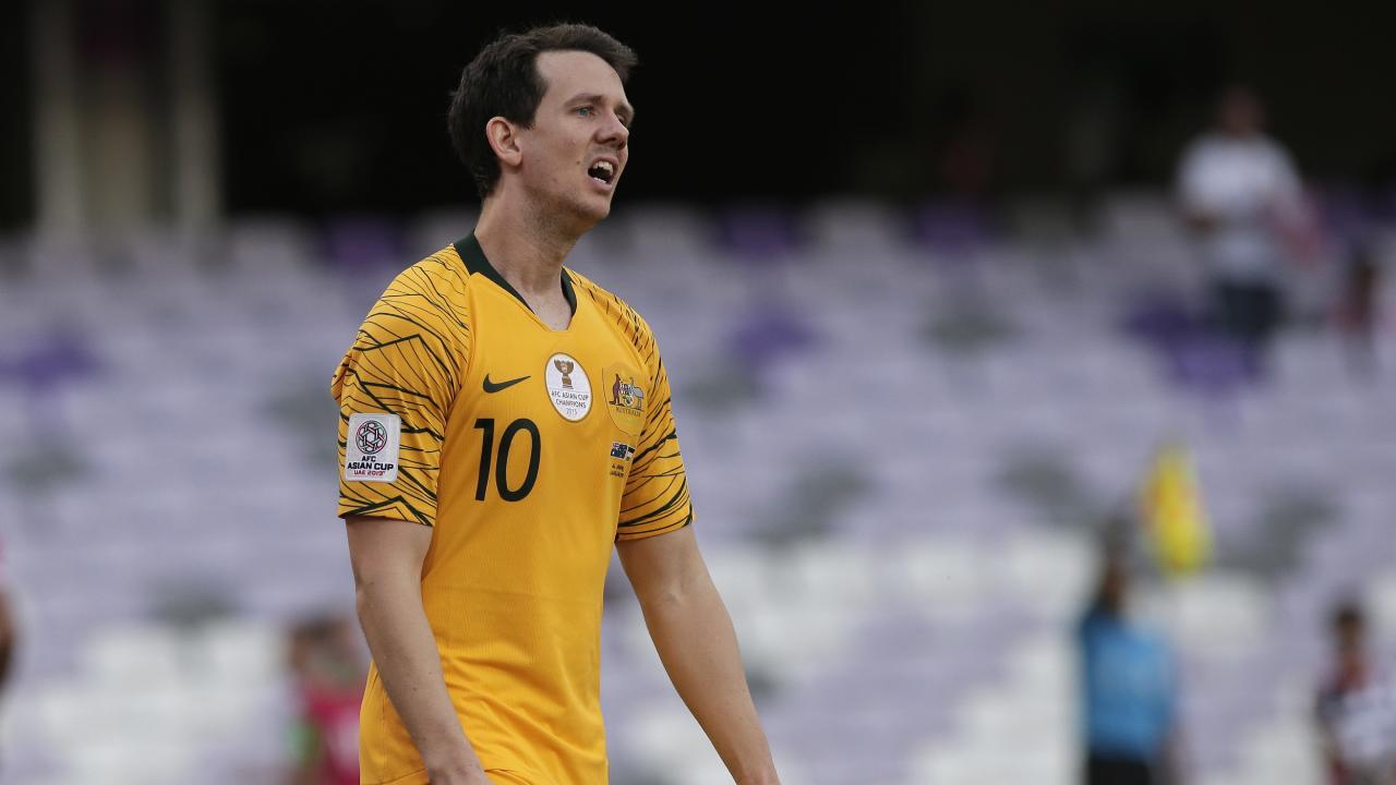 Australia's midfielder Robbie Kruse walks in dejection