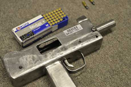 Darling Downs Tactical Crime Squad allegedly seized a homemade submachine gun, a MAC-10, from a Harristown home on Thursday.