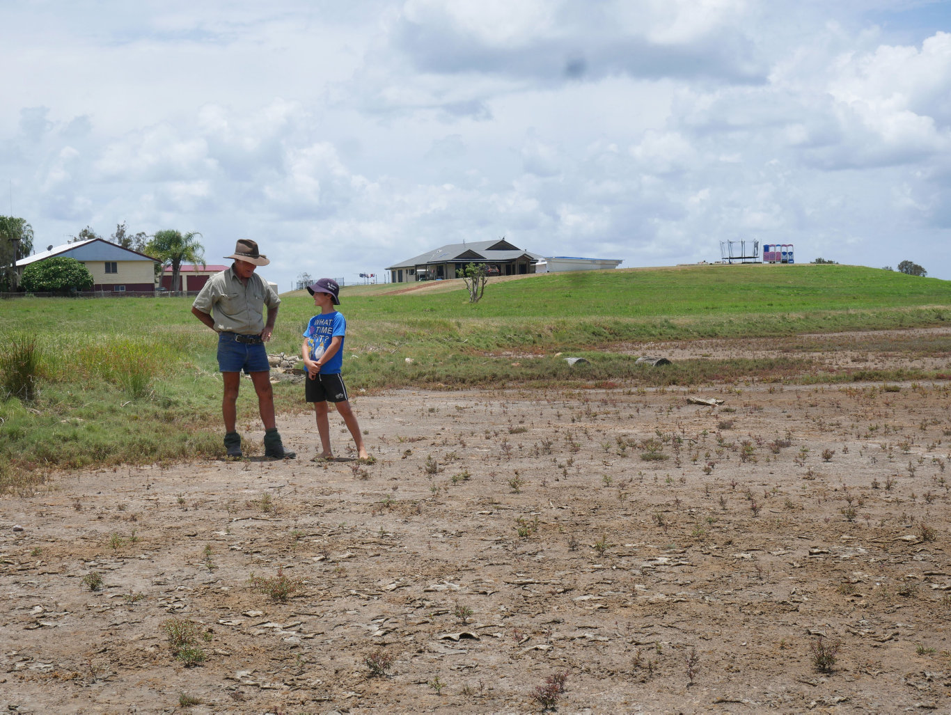 Lindsay Titmarsh and his grandson Josh at the site on the Tandora property where crocodile tracks have been seen.
