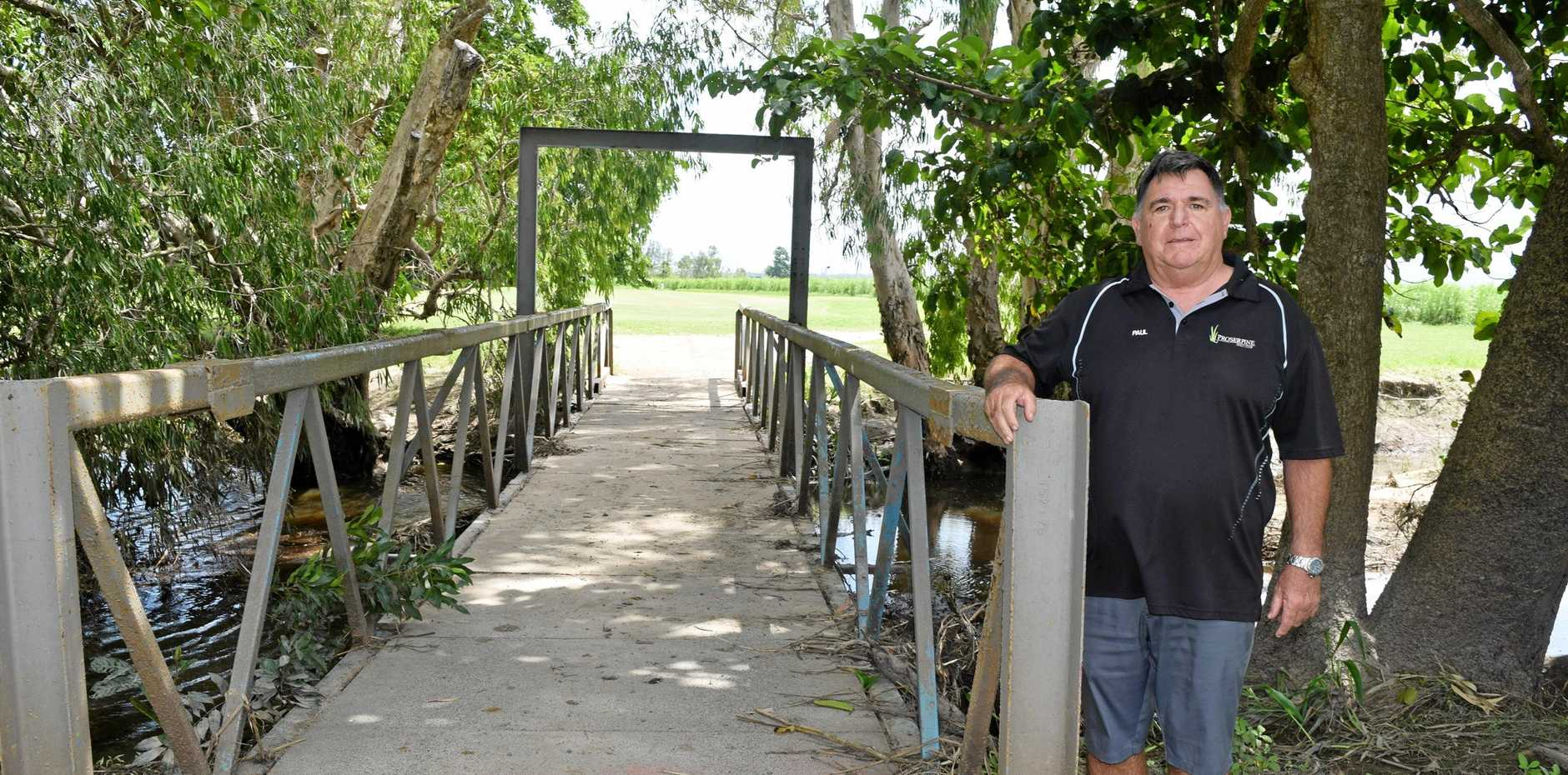OUT WITH THE OLD: Proserpine Golf Club manager Paul Nicol with the bridge at the course that is to be replaced with a gangway from Shute Harbour.