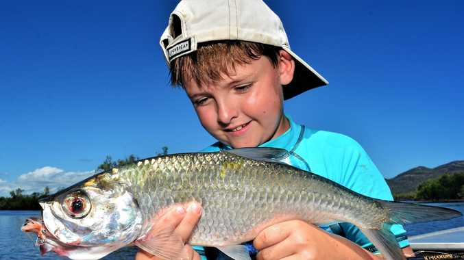 TOP CATCH: Reef Underwood with his first-ever fish on a fly rod - a nice tarpon.