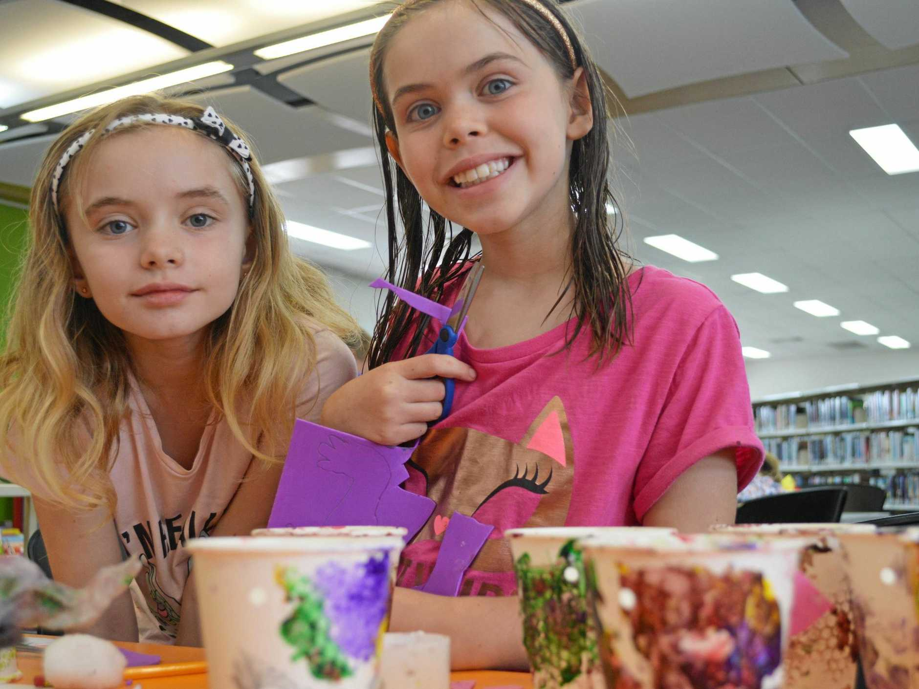 Paige and Elly Mueller take part in school holiday activities at Kingaroy Library.