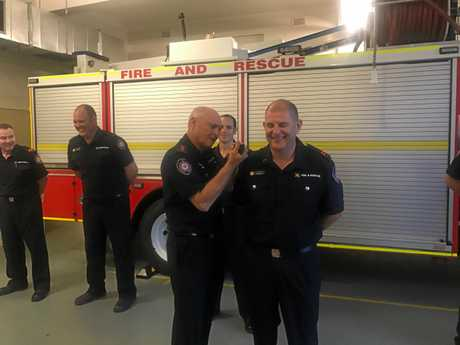 Gympie Captain Peter Groves retirement - Is Captain Peter Groves presenting Aux F/F Grant Russell his 10 year epaulets on his last parade