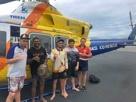 The five men who were rescued after their ute was washed away in flood waters.