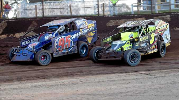 Ray Klarich (left) and Tim Morse racing wheel-to-wheel in a V8 Dirt Modified duel. Klarich will race at next week's national championship at Toowoomba Speedway.