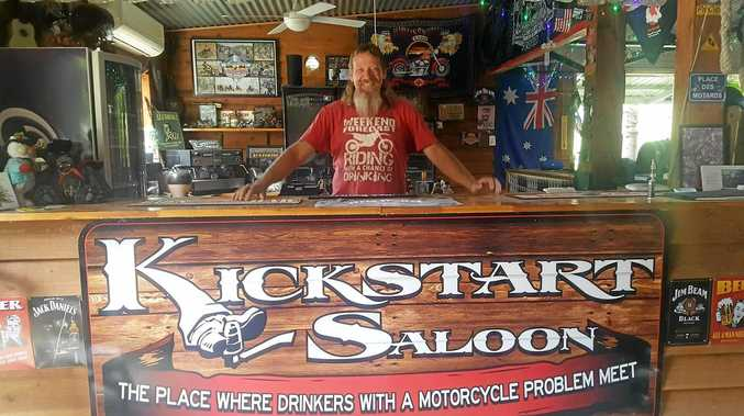 Des McCallum behind the Kickstart Saloon bar at Adventure Riders Ranch.