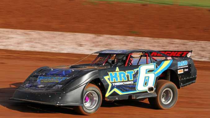 FAMILY LINKS: Wayne Randall in action in his super sedan at Lismore Speedway.