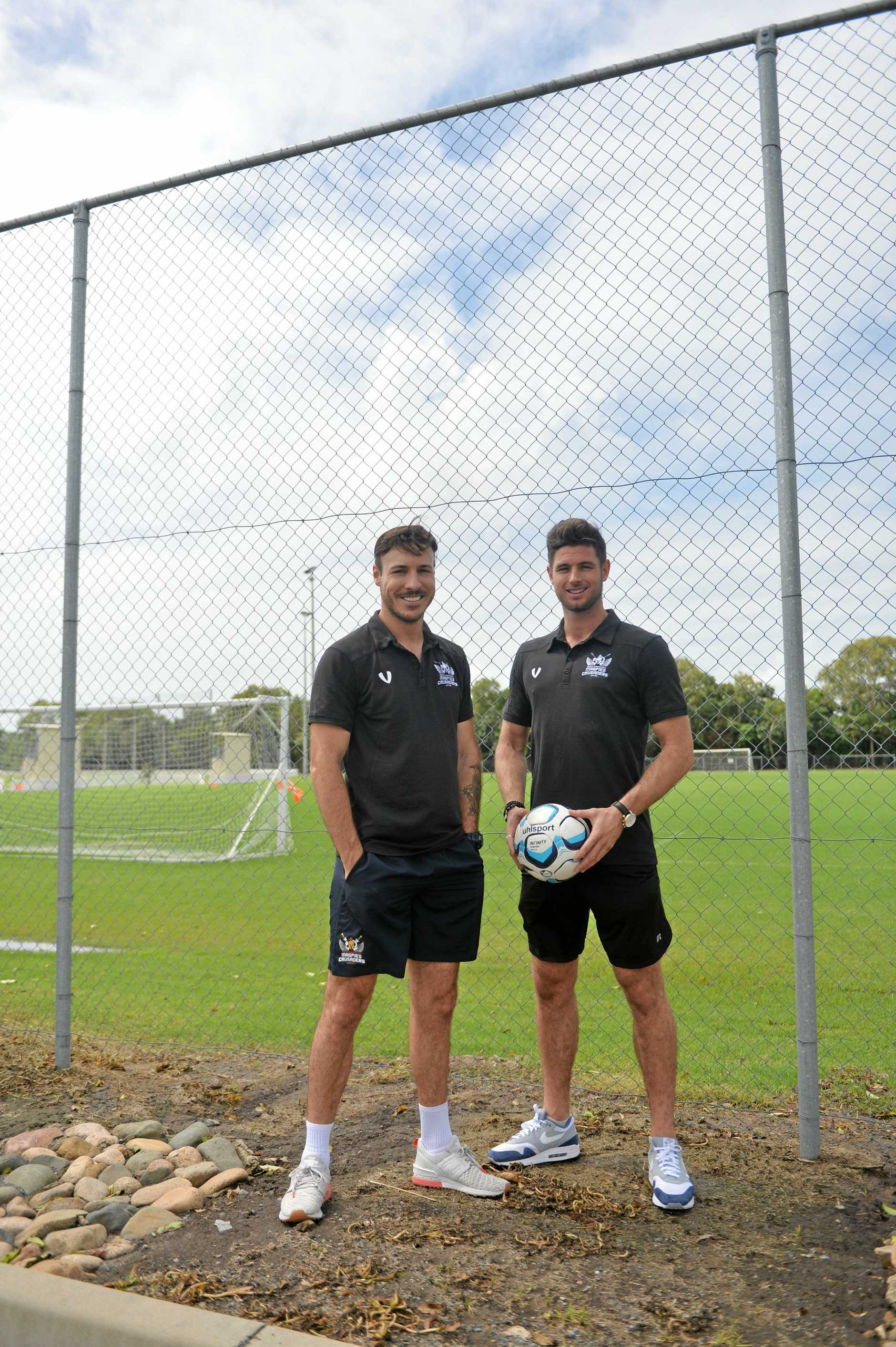 New Magpies Crusaders centre-back Shane McInerney (left) and head coach Chris Gallo.