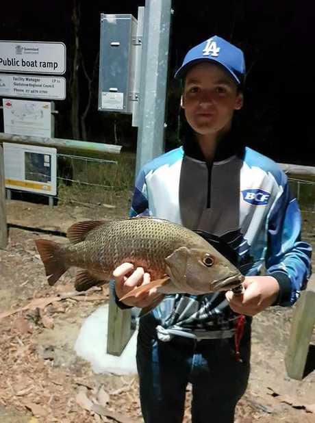 Caleb Fagg with his 45cm mangrove jack.