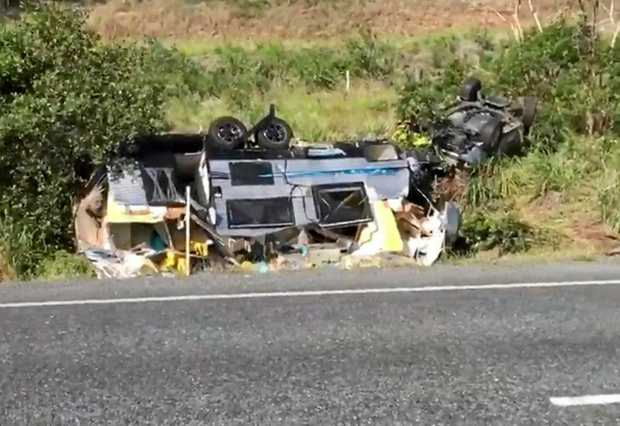 HIGHWAY CRASH: The 4WD and caravan rolled on the Bruce Highway near Yaamba this afternoon.