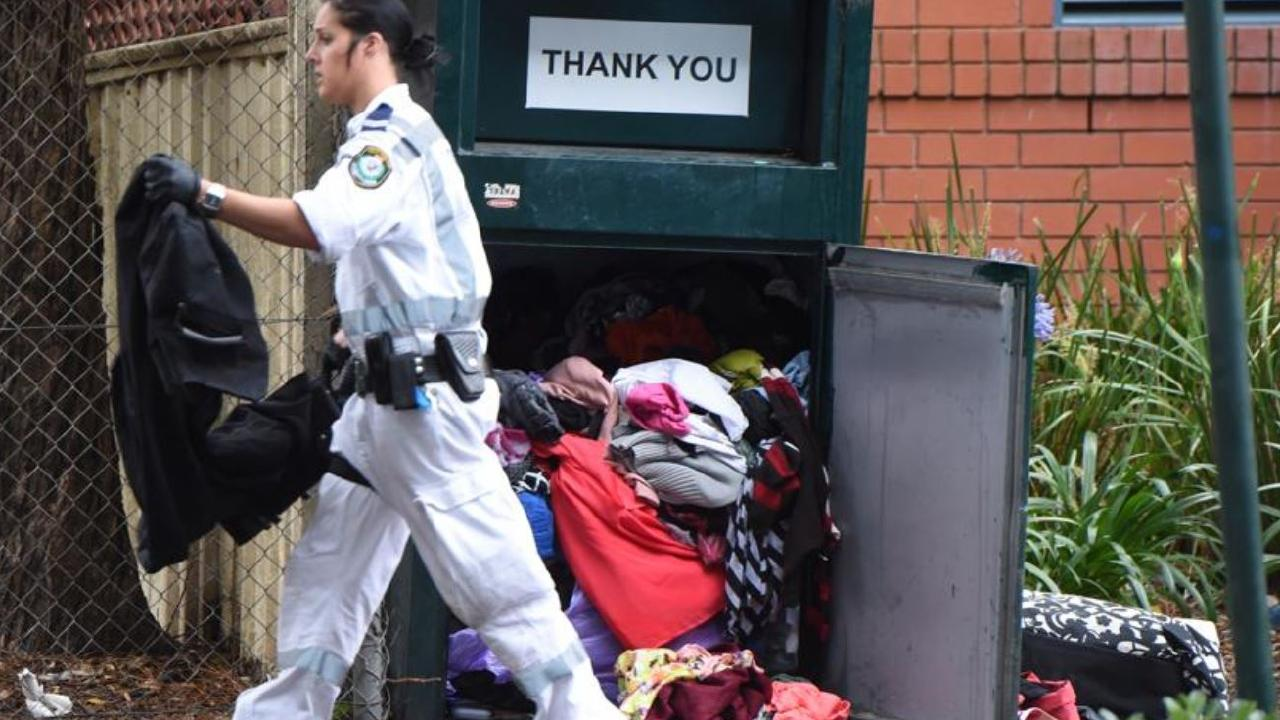 The bin in which the man was found once prized open. Picture: AAP Image/Dean Lewins.