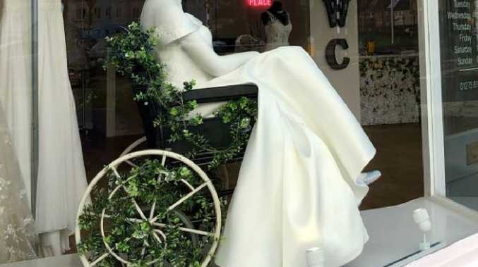 People are praising this bridal store for featuring a wedding dress on a mannequin in a wheelchair. Source: The White Collection Bridal Boutique