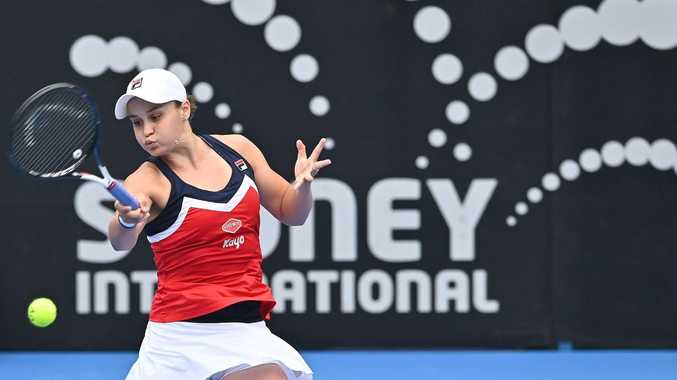 Australia's Ashleigh Barty hits a return to Kiki Bertens of the Netherlands during their women's singles semi-final match at the Sydney International tennis tournament in Sydney on January 11, 2019. (Photo by PETER PARKS / AFP) / -- IMAGE RESTRICTED TO EDITORIAL USE - STRICTLY NO COMMERCIAL USE --