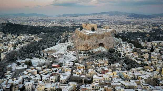 Snow covers parts of the ancient Acropolis hill and Plaka, the tourist district of Athens, Greece as temperatures drop to -23C. Picture: AP
