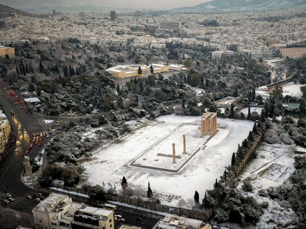Snow covers the archaeological site of the temple of Zeus and the National Garden in Athens, Greece, with temperatures in parts of the country plunging well below freezing. Picture: AP