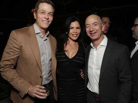 Patrick Whitesell, Lauren Sanchez and Amazon CEO Jeff Bezos attend Jeff Bezos and Matt Damon's 'Manchester By The Sea' Holiday Party in LA in 2016. Picture: Todd Williamson/Getty Images for Amazon Studios