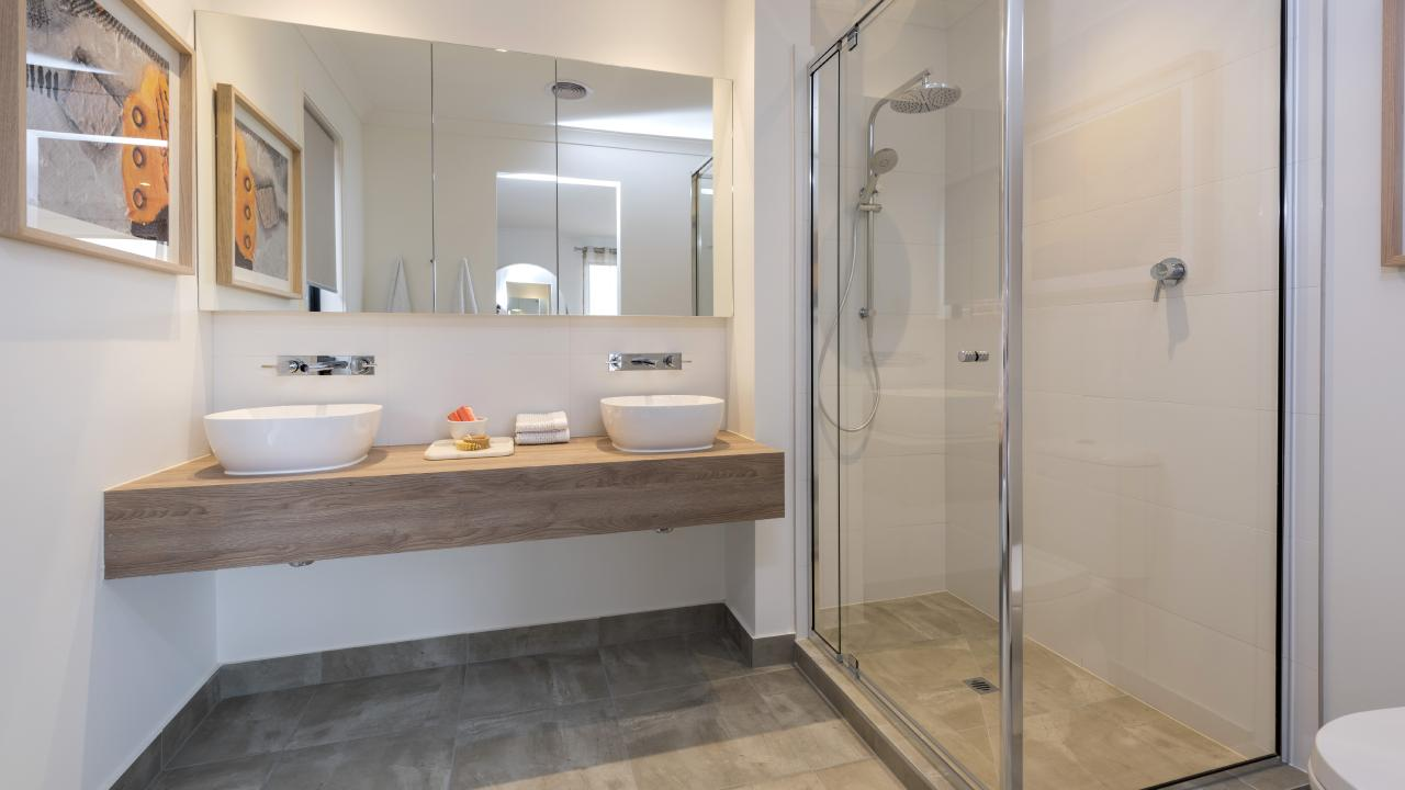 A floating vanity makes the ensuite look more spacious.