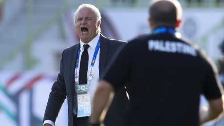 Graham Arnold calls the shots during Australia's clash with Palestine at Al Maktoum Stadium. Picture: AP
