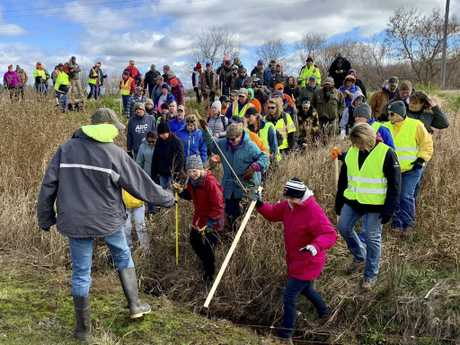 Volunteers searching for Jayme in October after her parents were found fatally shot. Picture: AP Photo/Jeff Baenen, File