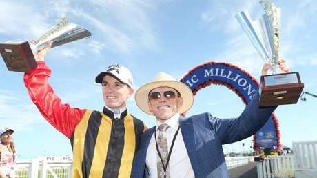 Jockey Tim Clark and trainer Chris Munce, delighted after  Boomsara's win. Photo: Jono Searle