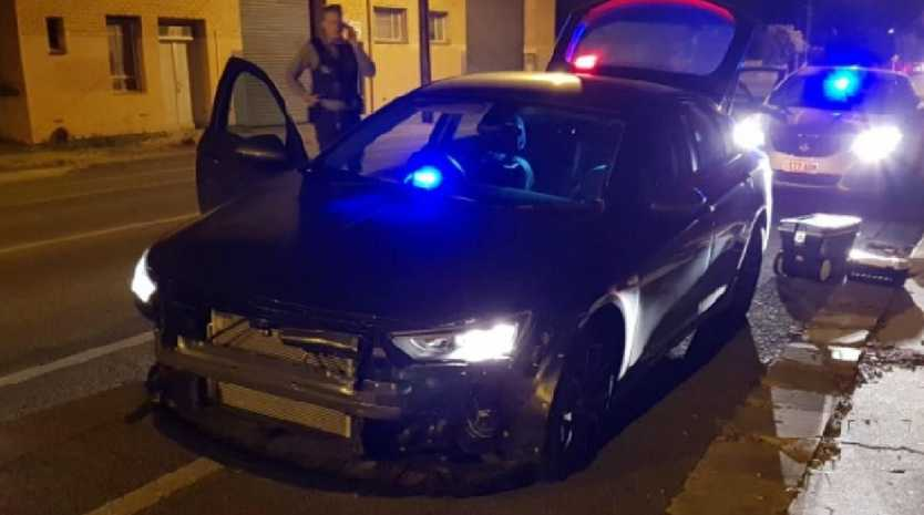 The damaged police car after it was rammed up to seven times by two men in a stolen BMW at Glanville.