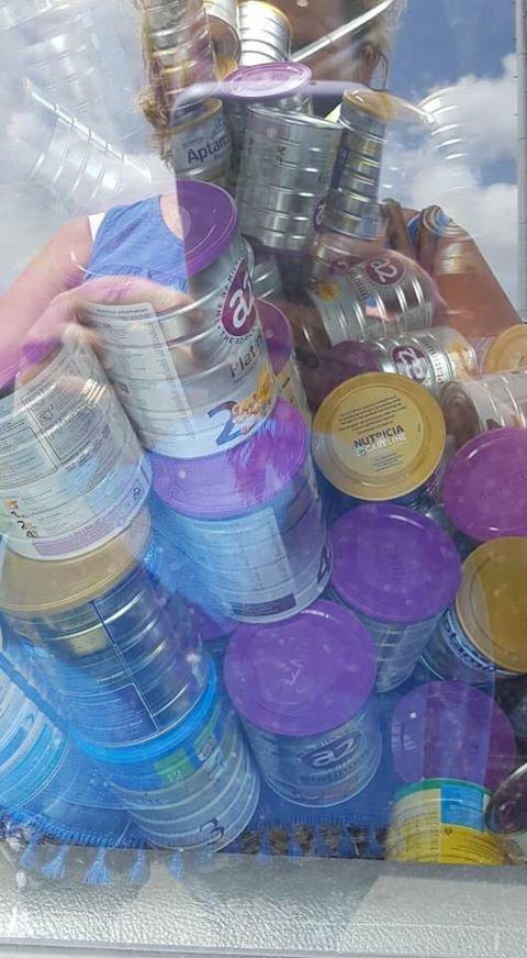 Photos show a man stockpiling baby formula around Bundaberg.