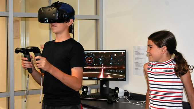 GET REAL: Art Lloyd-Jones takes on those pesky aliens with the help of the HTC Vive virtual reality headset at the Dalby library.