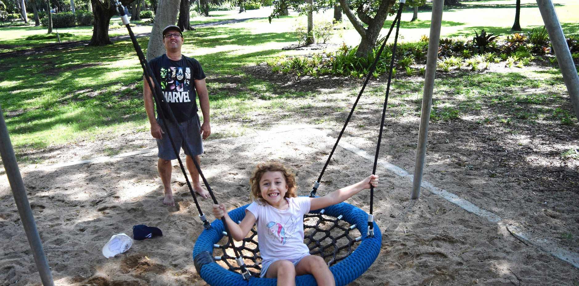 POPULAR SPOT: Tahnee Gregurke, 7, swings at Queens Park with the help of her father Simon Gregurke.