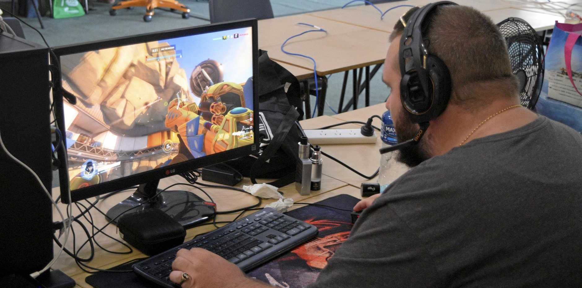 IN THE THICK OF THE ACTION: Scott Kearns at the Coffs Gaming League 12-hour LAN party on Saturday.