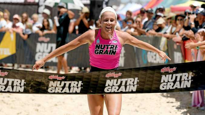 WINNING FEELING: Lennox Head's Hannah Sculley takes out the Nutri-Grain Ironwoman round at Currumbin on the Gold Coast.