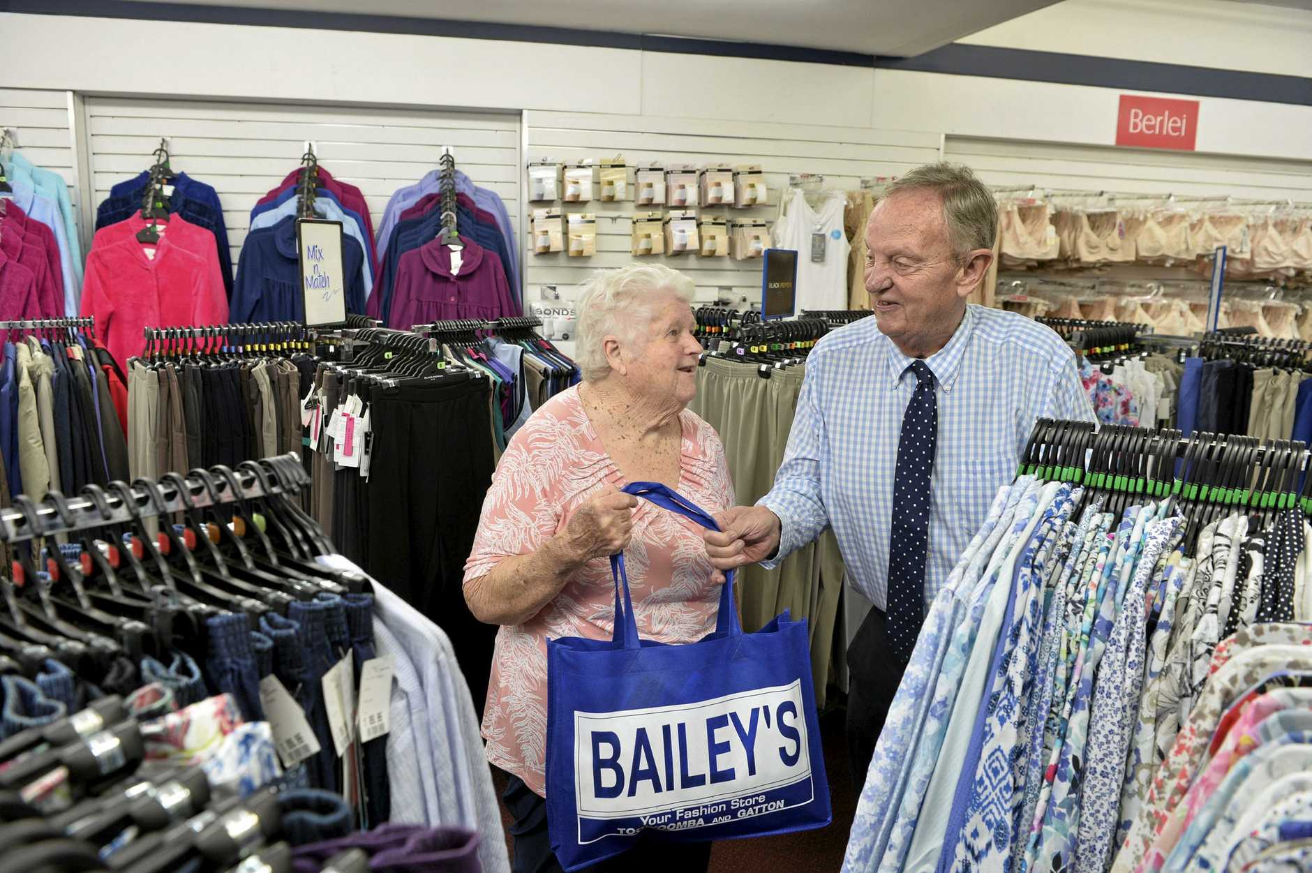 Bev Young has been shopping at   iconic Toowoomba store Bailey's for 65 years. She buys her last purchase with owner Lex Bailey as he announces the business will close, Saturday, January 12, 2019.