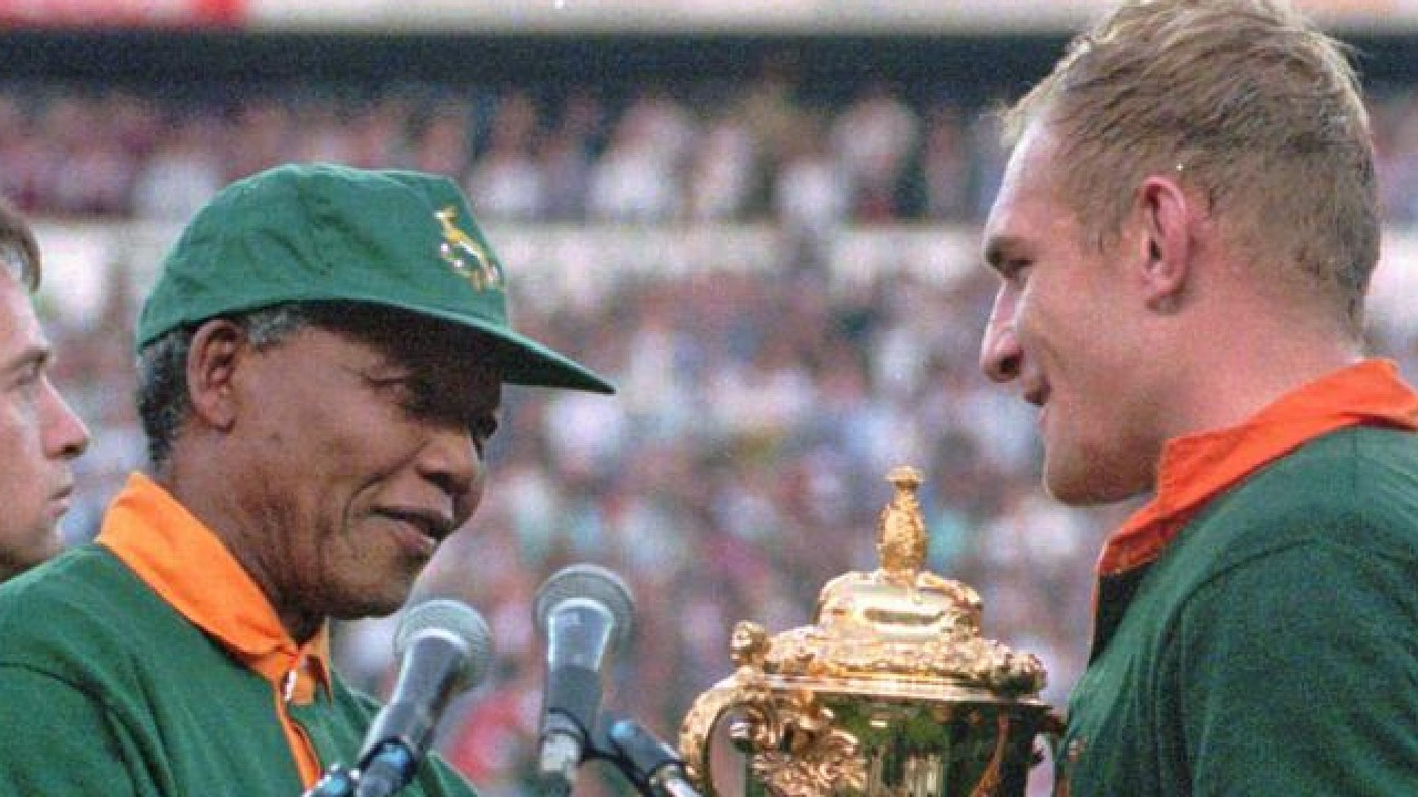Francios Pienaar receives the Rugby World Cup from Nelson Mandela in 1995.