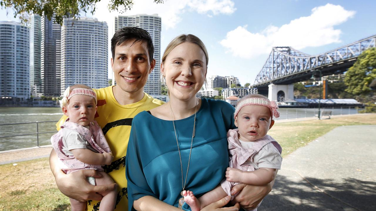 Willow (4 months), Cameron, Carol and Harper (4 months) Thomas migrated to Australia from South Africa and have been in Brisbane for five years now. Picture: AAP Image/Josh Woning