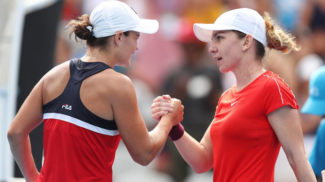 Ash Barty shakes hands with Simona Halep. Picture: Brett Costello