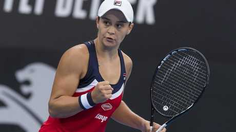 Ash Barty celebrates a win over Elise Mertens.