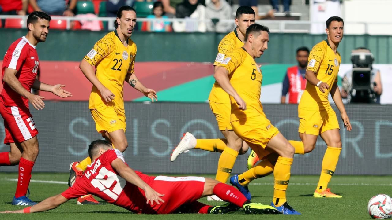 Milligan's versatility is key for Arnold. (Karim Sahib / AFP)