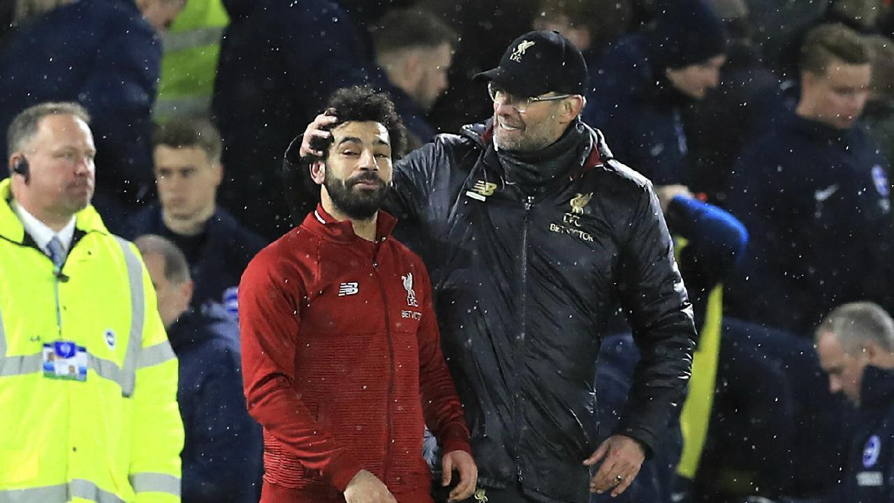Liverpool manager Jurgen Klopp, right, and Mohamed Salah celebrate