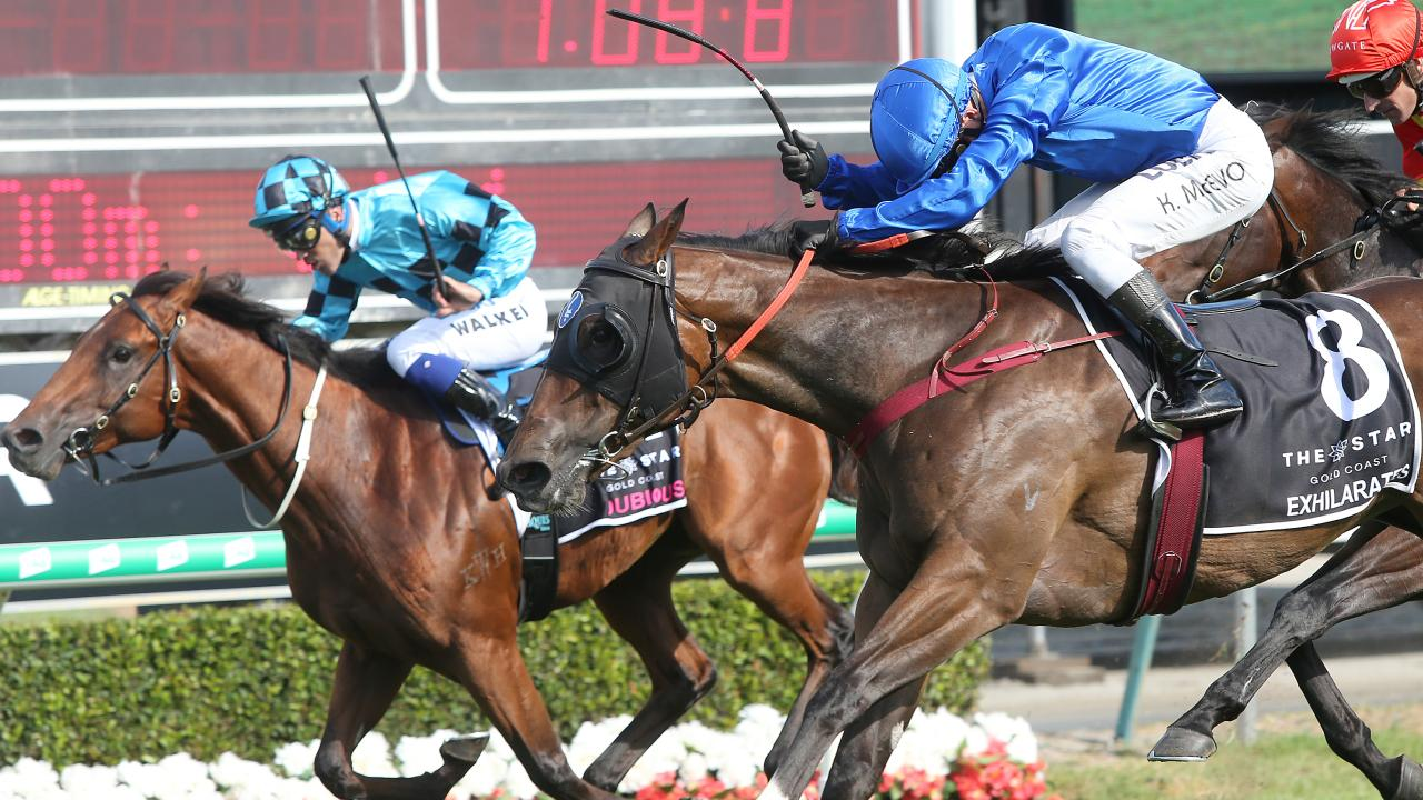 Dubious (left) was reeled in by Exhilarates in the magic Millions Classic. Picture: AAP