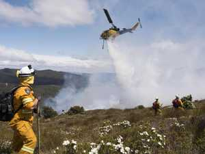 Waterbombing aircraft, crews fight 'fast-moving fire'