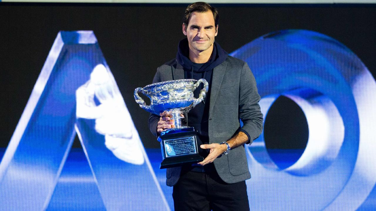 Reigning Australian Open champion Roger Federer poses with the trophy.