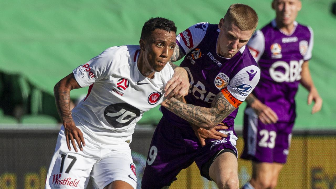 Keanu Baccus does his best to hold off Andy Keogh at HBF Stadium. Picture: AAP