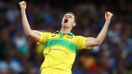 Jason Behrendorff celebrates the wicket of MS Dhoni.